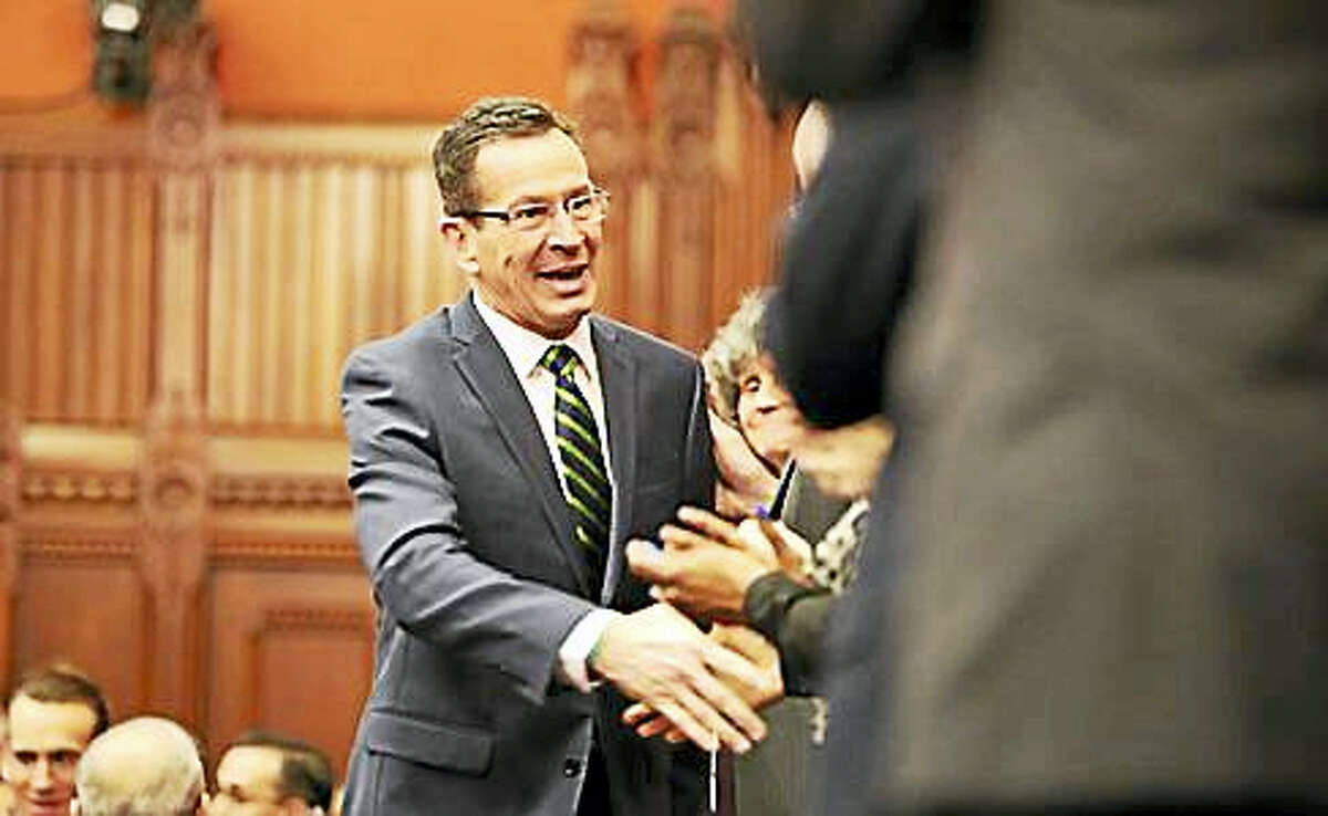 Gov. Dannel P. Malloy shakes hands with constitutional officers as he enters the House chamber.
