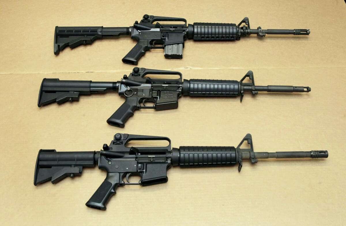 Three variations of the AR-15 rifle are displayed at the California Department of Justice in Sacramento. Omar Mateen used an AR-15 that he purchased legally when he killed 49 people in an Orlando nightclub over the weekend.