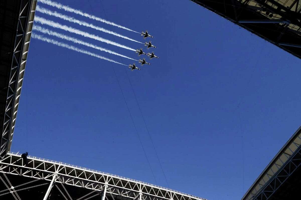 Military aircraft pass over University of Phoenix Stadium before Sunday's Super Bowl in Glendale, Ariz.
