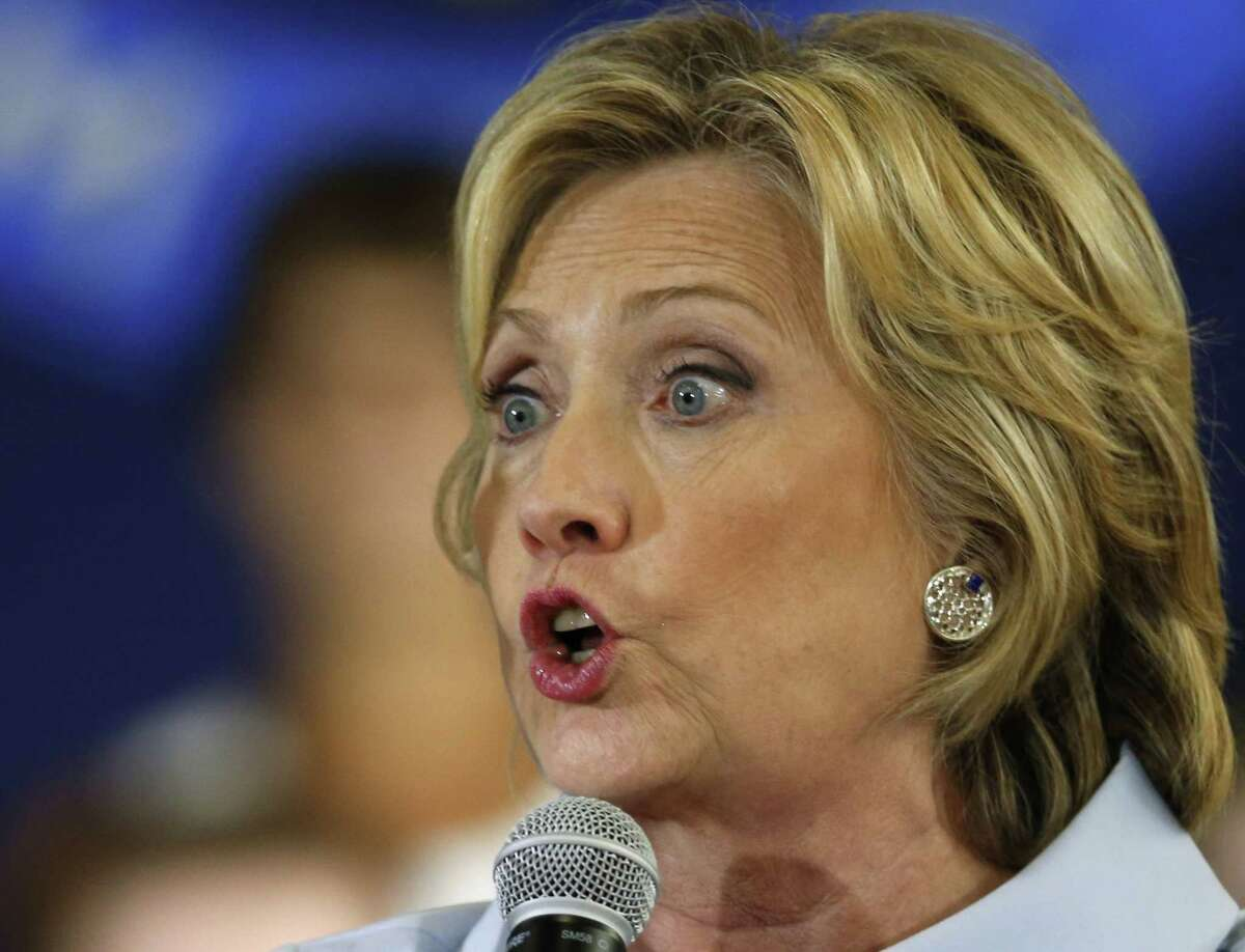 In this Sept. 18, 2015, photo, Democratic presidential candidate Hillary Rodham Clinton speaks at a campaign organizing meeting in Portland, Maine. Russia-linked hackers tried at least five times in August 2011 to trick Hillary Rodham Clinton into infecting her computer systems while she was secretary of state, according to newly released emails from the State Department.