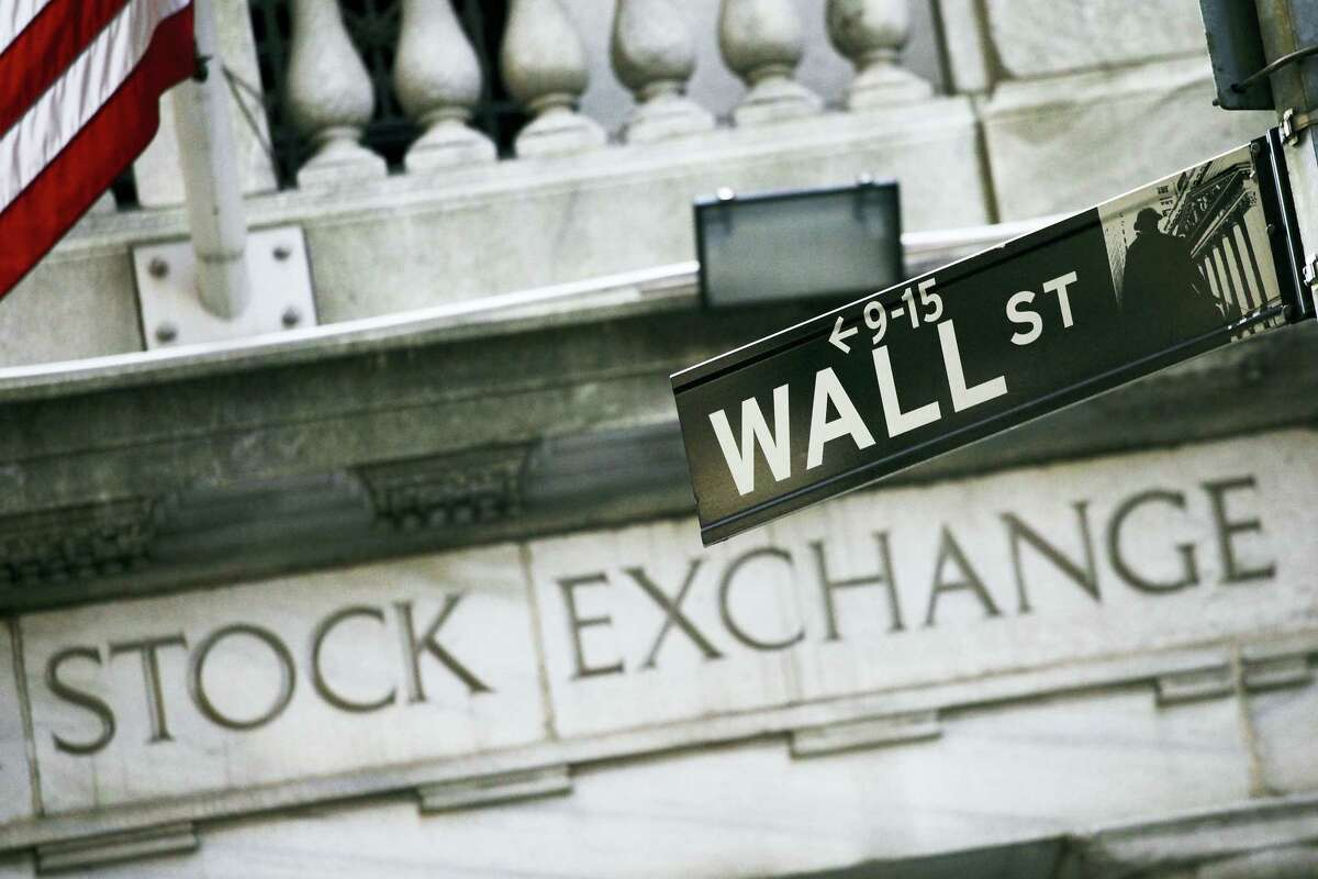This file photo shows a Wall Street street sign outside the New York Stock Exchange.