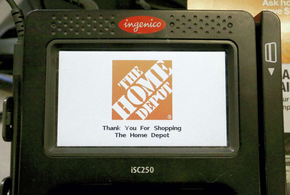 In this Wednesday, May 18, 2016 photo, the Home Depot logo appears on a credit card reader at a Home Depot store in Bellingham, Mass. The Home Depot Inc. says in a new federal lawsuit that Visa and MasterCard are using security measures prone to fraud, putting it and other retailers at risk of hacking attacks by cyber thieves.