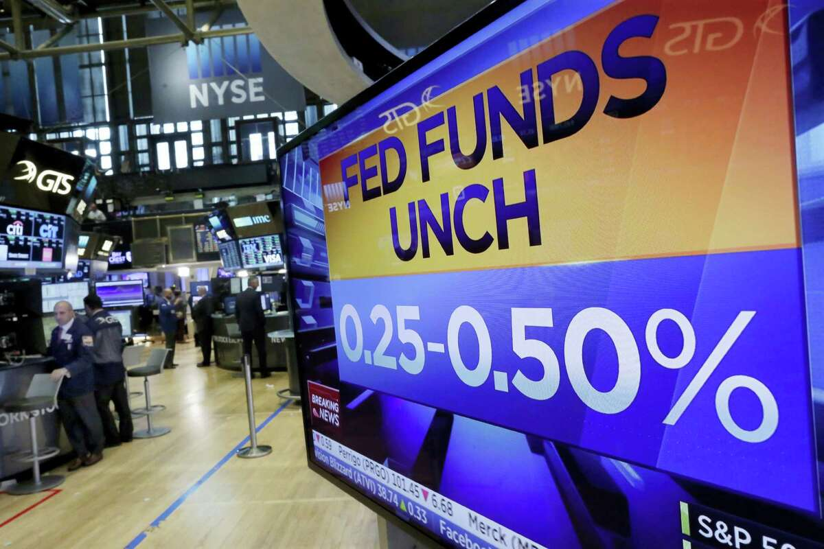 A television screen on the floor of the New York Stock Exchange shows the Federal Reserve's rate decision Wednesday.