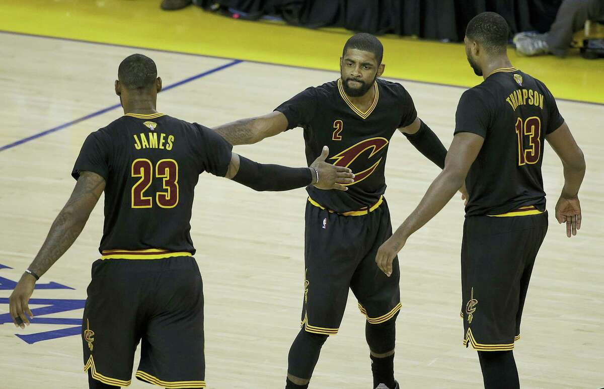 Cavaliers guard Kyrie Irving, center, forward LeBron James, left, and center Tristan Thompson react during the second half of Game 5 of the NBA Finals on Monday.