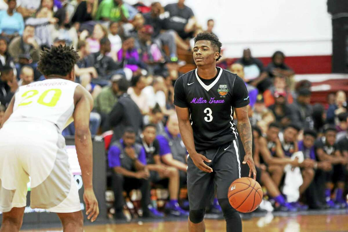 Miller Grove's Alterique Gilbert #3 against Oak Hill in the DICK'S Sporting Goods High School National Basketball Tournament on Friday, April 1, 2016 in Queens, NY. Oak Hill won the game. (AP Photo/Gregory Payan)