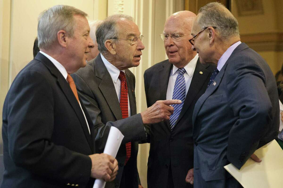 Senate Judiciary Committee Chairman Sen. Charles Grassley, R-Iowa, second from left, talks with Sen. Charles Schumer, D-N.Y., right, and Sen. Patrick Leahy, D-Vt., ranking member on the Senate Judiciary Committee, and Senate Minority Whip Richard Durbin of Ill., left, on Capitol Hill in Washington, Thursday, Oct. 1, 2015, before a news conference to discuss criminal justice reform.