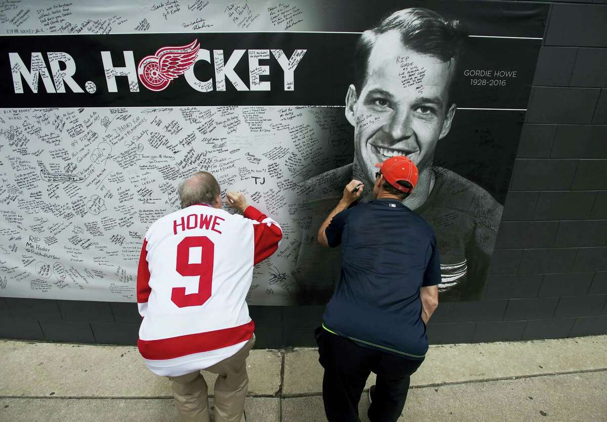 People sign a memorial wall as fans pay their respects to NHL Hall-of-Famer Gordie Howe in Detroit on Tuesday.