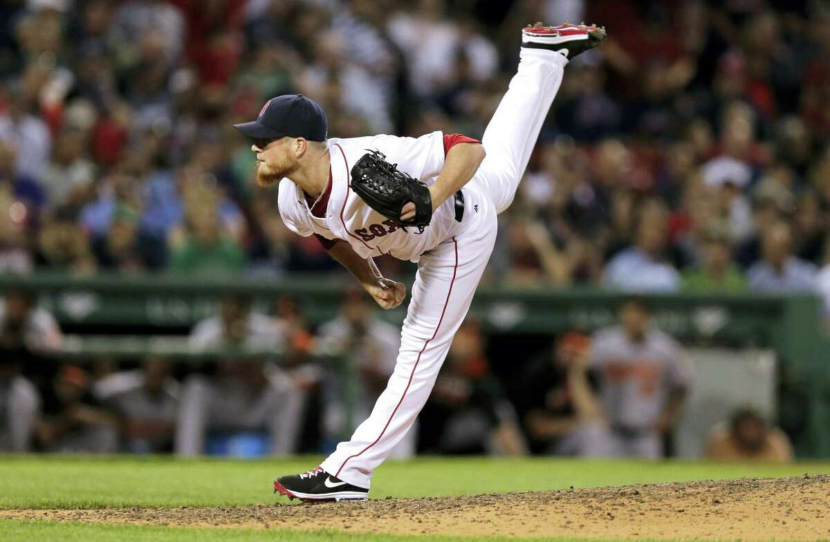 Boston Red Sox relief pitcher Craig Kimbrel delivers during the ninth inning against the Baltimore Orioles at Fenway Park Tuesday. The Orioles defeated the Red Sox 3-2.