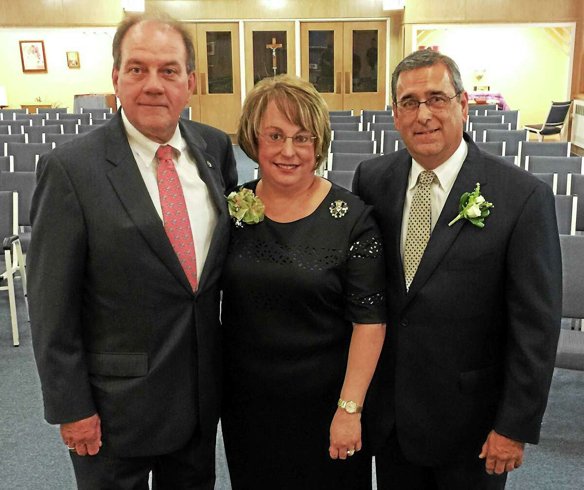 The recipients of the 2015 Wisdom Awards were honored Wednesday evening with a gathering and dinner at the Wisdom House Retreat and Conference Center. From left, William G. Harding, Susan Cook and Timothy Cook.