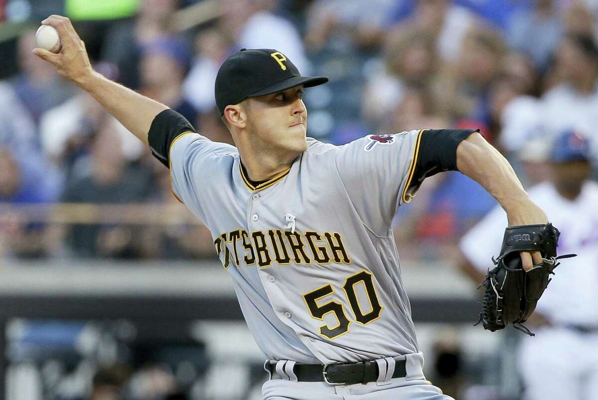 Pittsburgh Pirates pitcher Jameson Taillon delivers against the New York Mets during the first inning Tuesday. The Pirates blanked the Mets 4-0.