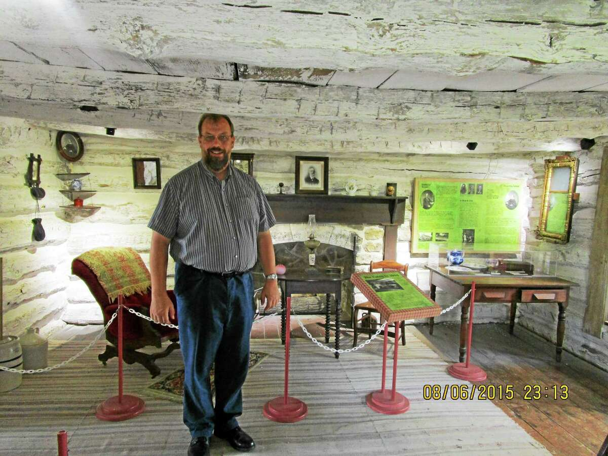 Historian Grady Atwater in the Adair Family Cabin at the John Brown Museum