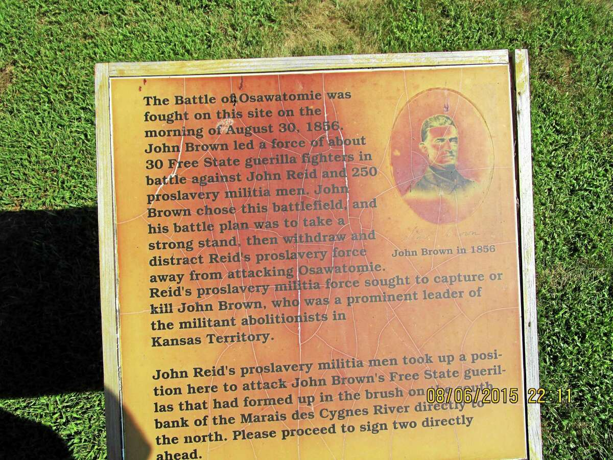Plaque depicting the scene of the first encounter between John Brown and the opposition at the Battle of Osawatomie.