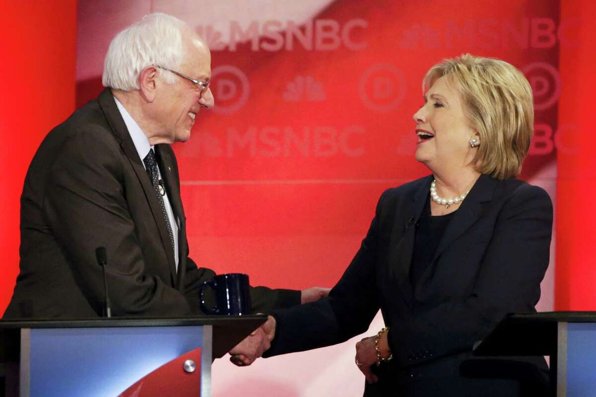 Democratic presidential candidate, Sen. Bernie Sanders, I-Vt, and Democratic presidential candidate, Hillary Clinton shake hands after a Democratic presidential primary debate hosted by MSNBC at the University of New Hampshire Thursday, Feb. 4, 2016, in Durham, N.H.