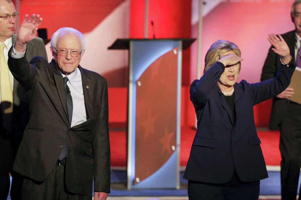 Democratic presidential candidate, Sen. Bernie Sanders, I-Vt, and Democratic presidential candidate, Hillary Clinton wave to audience members after a Democratic presidential primary debate hosted by MSNBC at the University of New Hampshire Thursday, Feb. 4, 2016, in Durham, N.H.