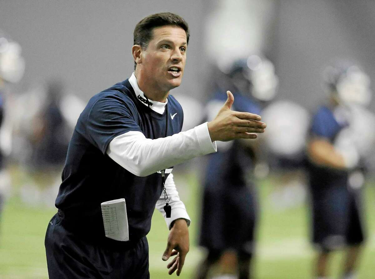 Connecticut head coach Bob Diaco gestures to his team during the first NCAA college football practice, Saturday, Aug. 2, 2014, in Storrs, Conn. (AP Photo/Jessica Hill)