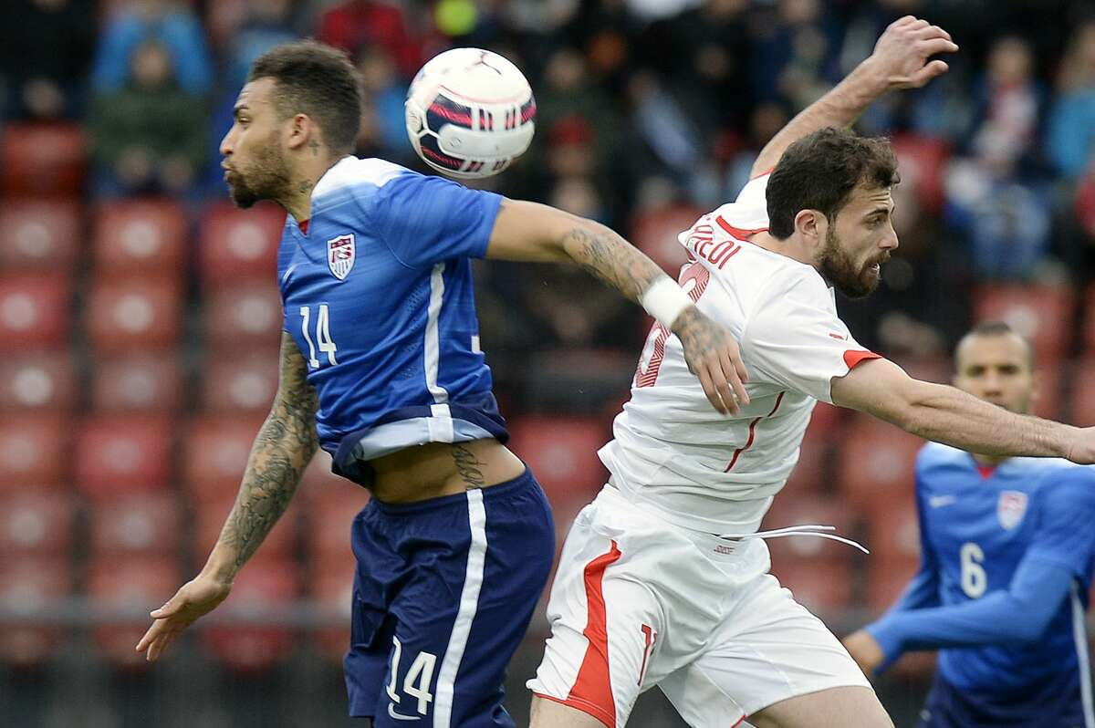 Switzerland's Admir Mehmedi, right, challenges for the ball with Danny Williams Tuesday at the Letzigrund stadium in Zurich, Switzerland.