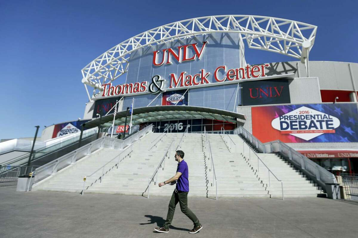 A pedestrian walks past the site for the third presidential debate between Republican presidential nominee Donald Trump and Democratic presidential nominee Hillary Clinton at UNLV in Las Vegas on Oct. 18, 2016.