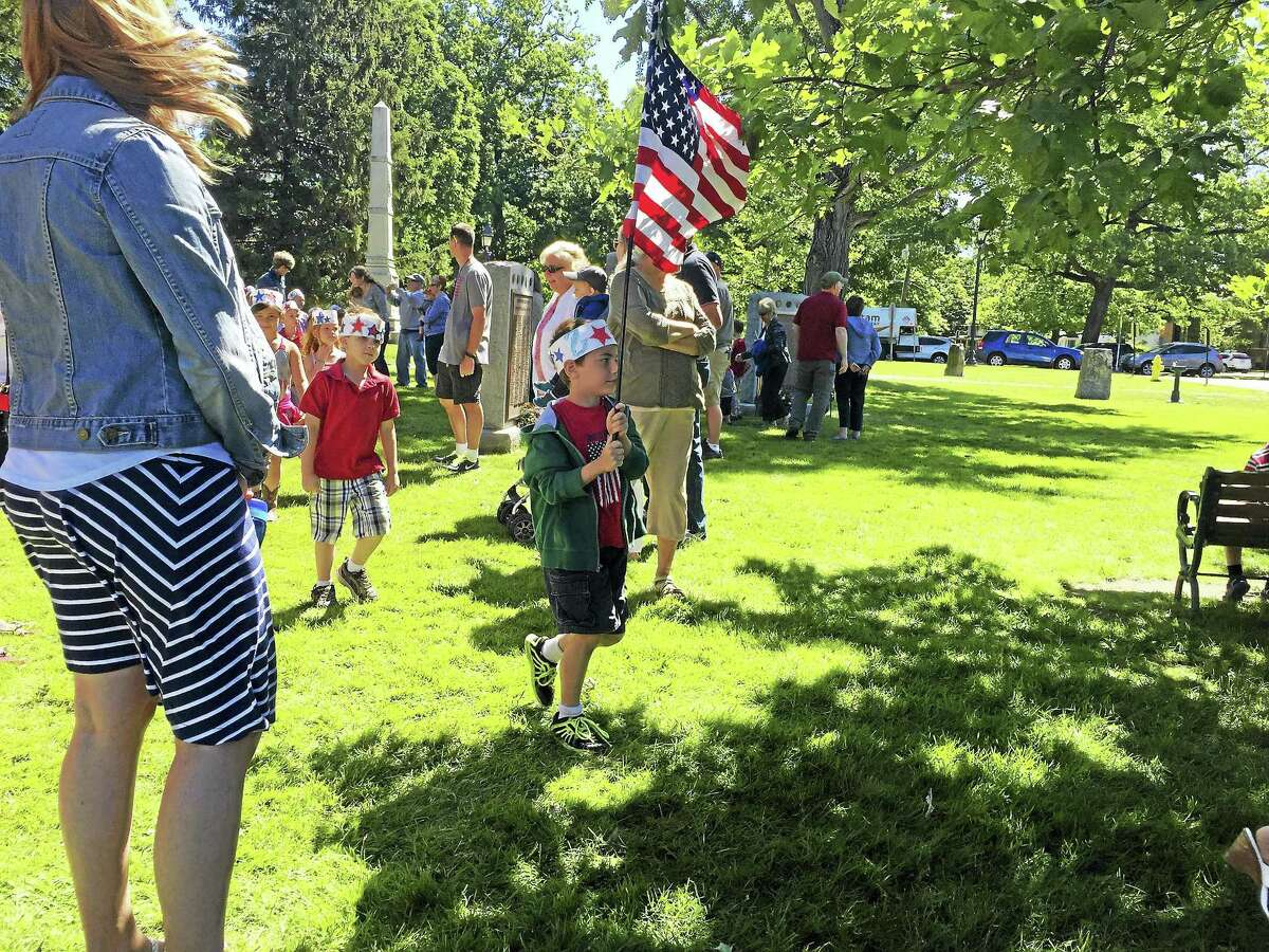 Ben Lambert - The Register Citizen In Litchfield, Center School students and residents gather to celebrate Flag Day Tuesday morning on the town green.