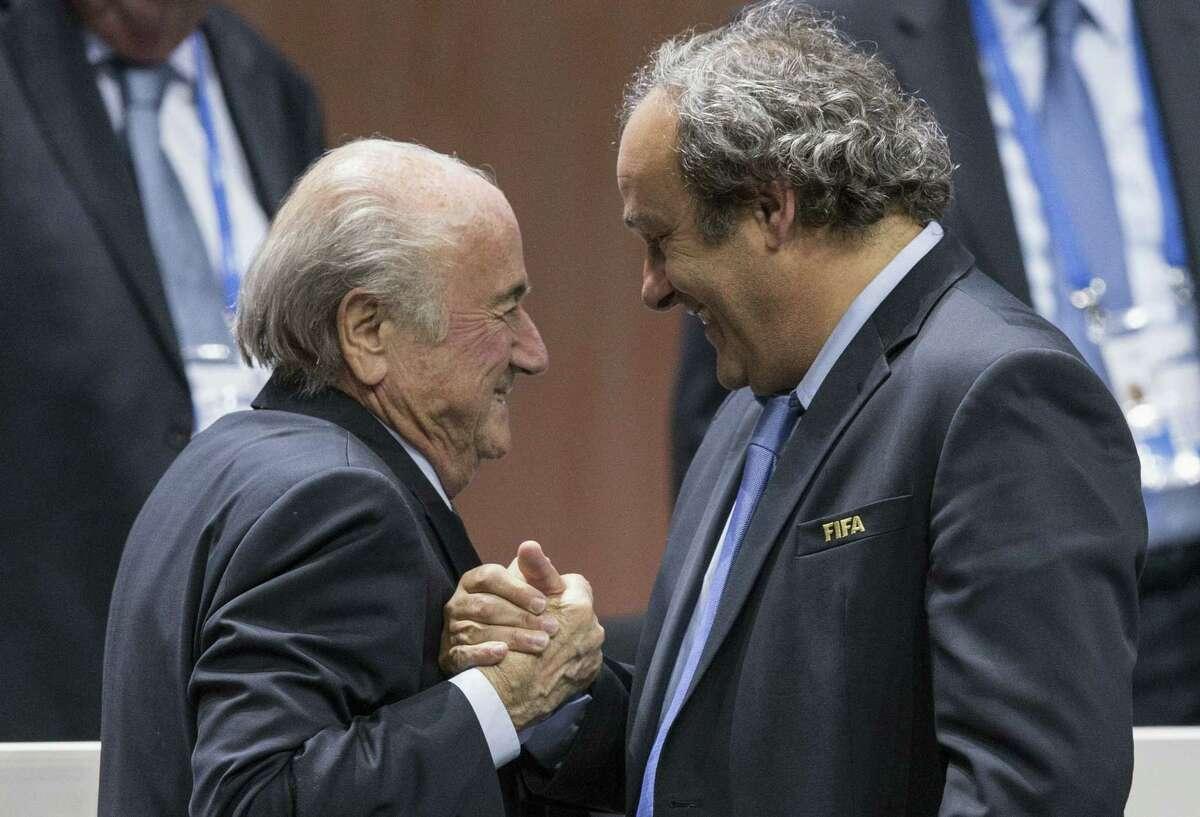 FIFA president Sepp Blatter, left, says he will resign.
