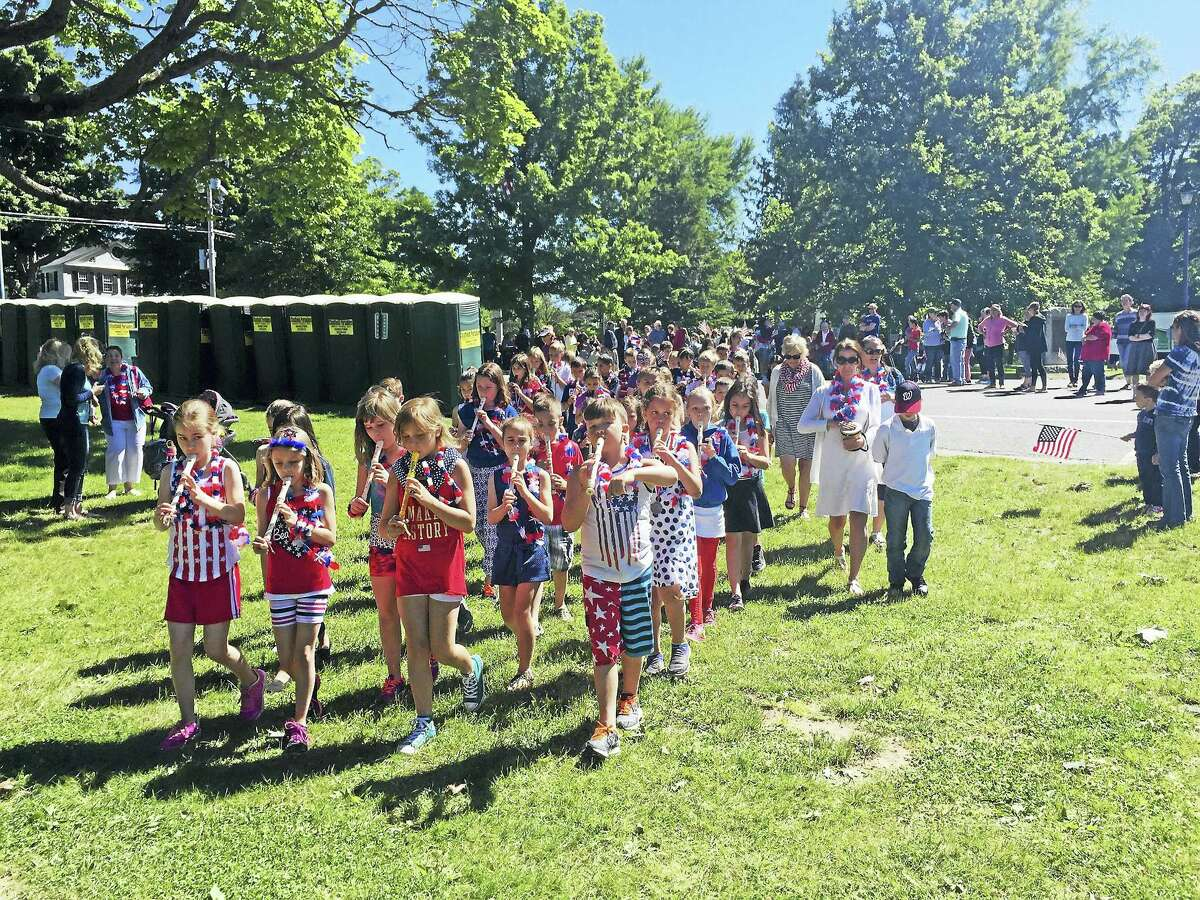 Ben Lambert - The Register Citizen Center School students play recorders during their procession on the Litchfield Green. The town celebrated Flag Day Tuesday morning with a brief ceremony.