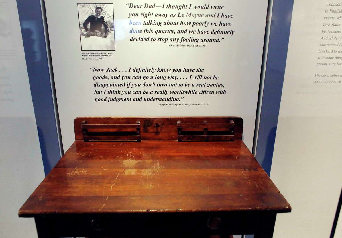 """In this Nov. 5, 2015 photo, a desk is displayed in the exhibit titled """"Young Jack"""" at the John F. Kennedy Presidential Library and Museum in Boston. An archivist at Choate, the private school in Connecticut where the president studied as a boy, insists the desk didn't belong to him."""