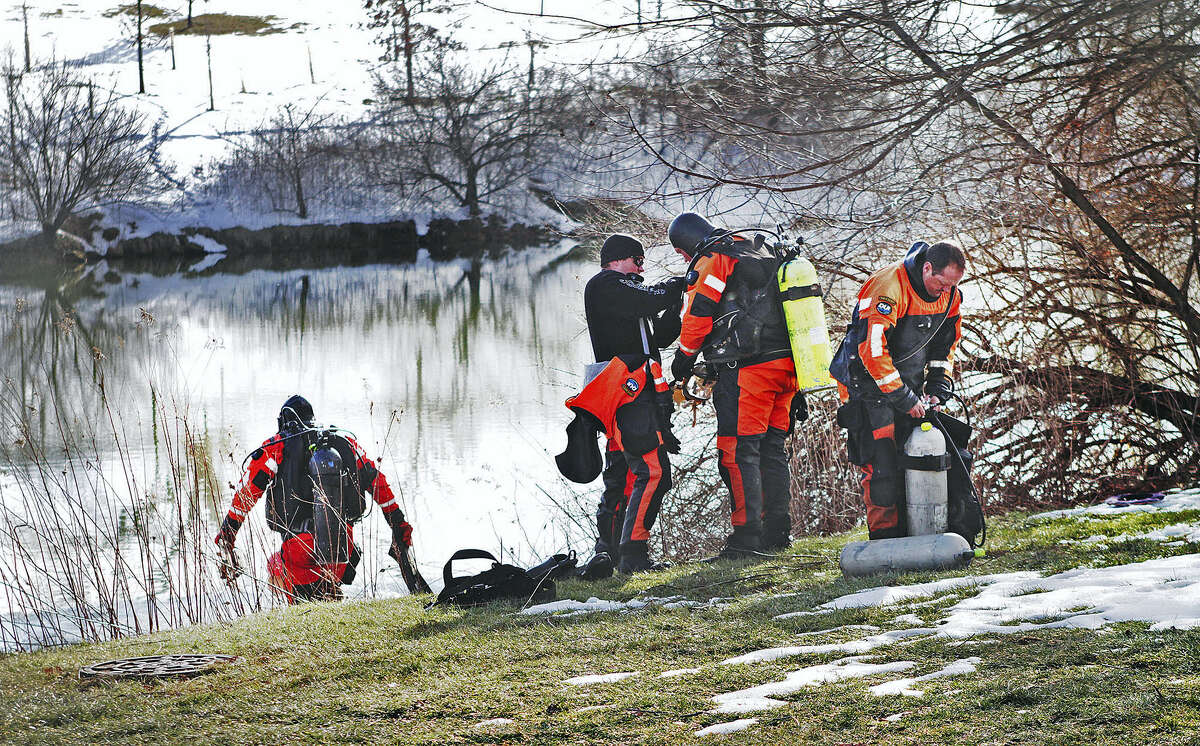 In this Jan. 31, 2016 photo, troopers prepare to search the Duck Pond in Blacksburg, Va. The investigation continued in the death of Nicole Madison Lovell as a state police search and recovery team searched the pond for evidence on the Virginia Tech Campus.