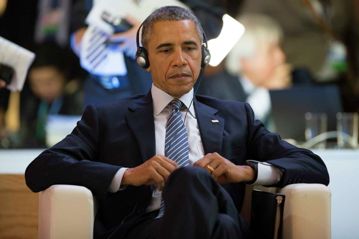 U.S. President Barack Obama waits for his turn to speak during the COP21, United Nations Climate Change Conference, in Le Bourget, outside Paris, Monday.