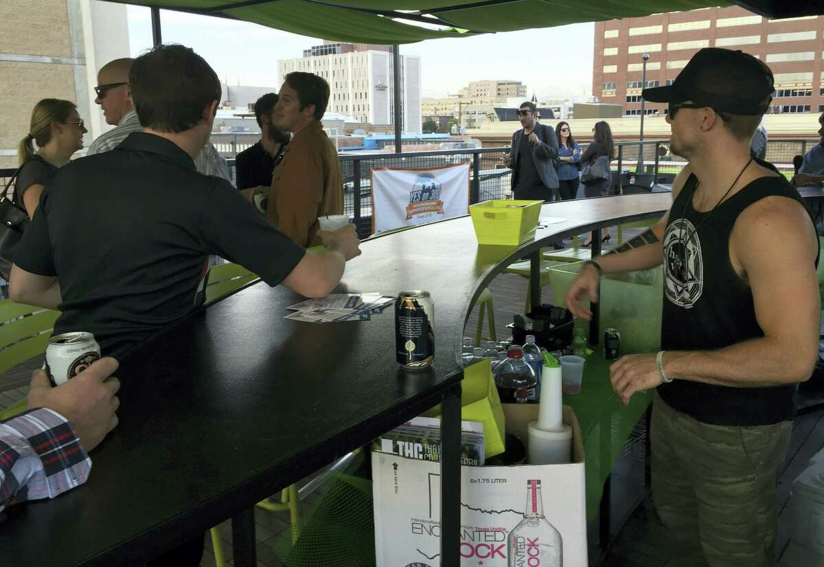 In this Sept. 22, 2016, photo, business owners in the new marijuana industry mingle at a political fundraiser in Denver. Business owners are replacing idealists in the pot-legalization movement as the nascent marijuana industry creates a donor base of entrepreneurs willing to spend to change drug policy.