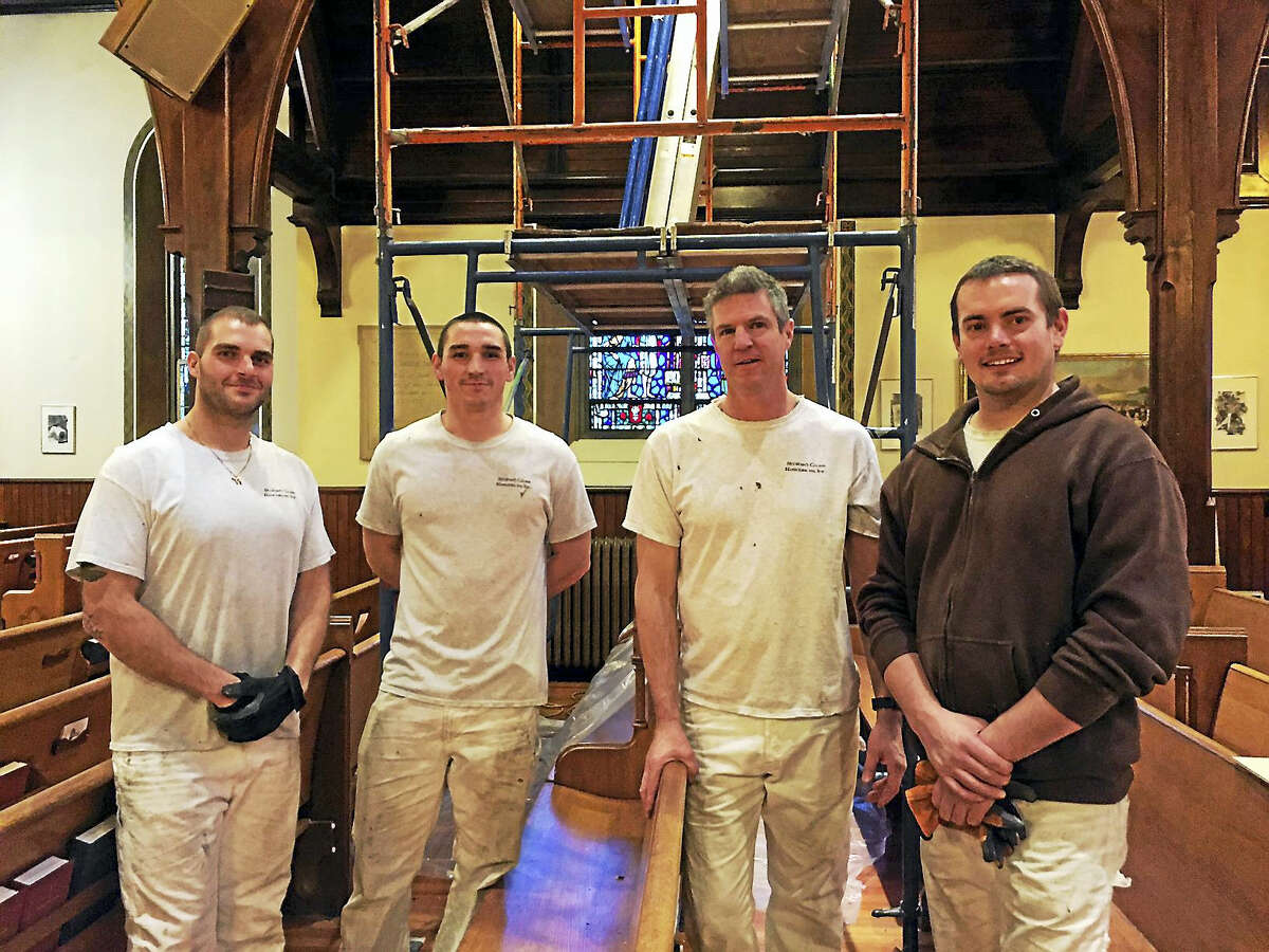 The crew from Stained Glass Resources of Hampden, Massachusetts - identified as Chad, Joe, Wade and Jared - work on Trinity Episcopal Church in Torrington.