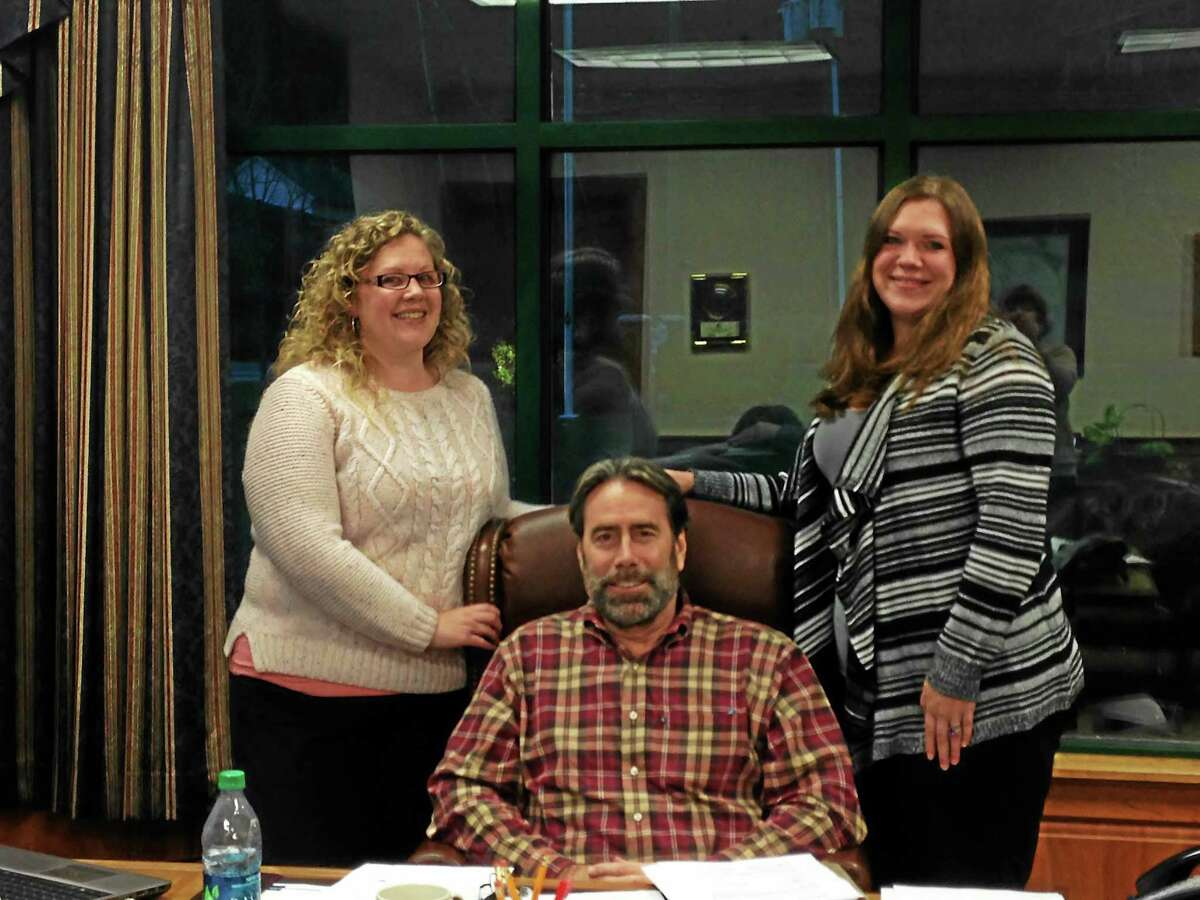 MANON MIRABELLI — THE REGISTER CITIZEN Jeff Lippincott, center, owner of Lippincott Van Lines in Winsted, with Melissa Engle, sales coordinator, left, and Jessica St. Pierre, customer service manager.