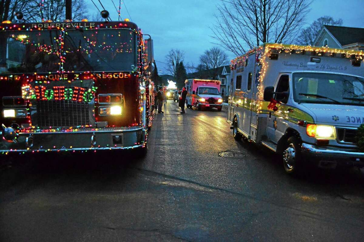 A fire truck gets ready to roll in the 2013 Winsted Fire Department Gator Christmas Parade.