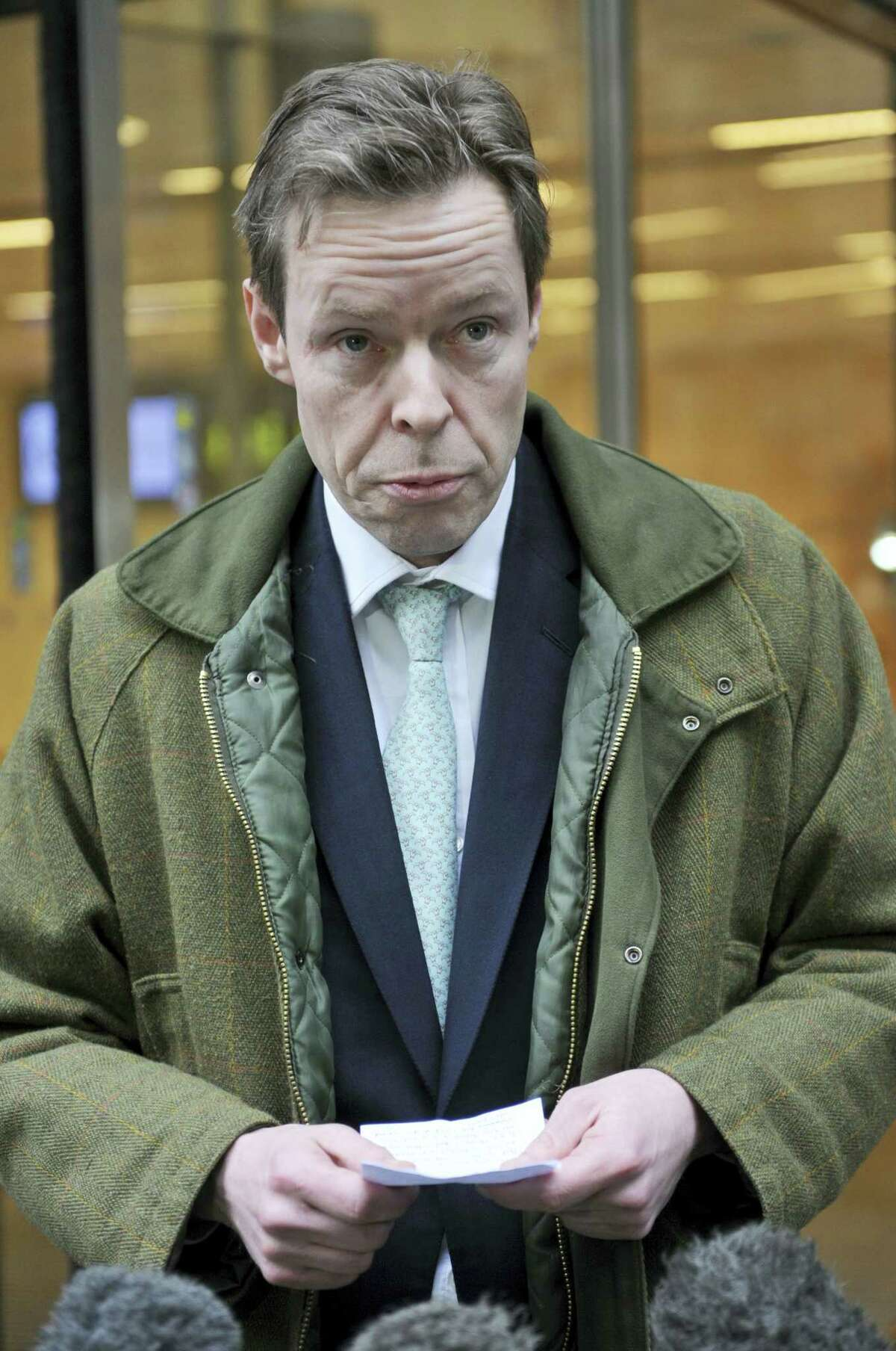 George Bingham, the only son of missing peer Lord Lucan, speaks to the media outside the High Court in London, where he was granted a death certificate by a High Court judge Wednesday Feb. 3, 2016. The only son of the notorious Lord Lucan, who has been missing since 1974 when a woman was found dead in his home, has been granted a death certificate in his father's case.