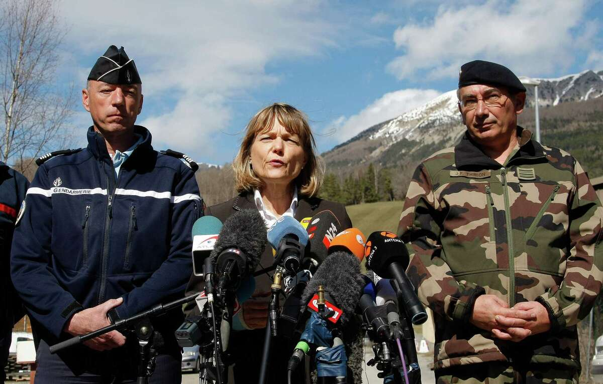 Patricia Willaert, center, the prefect in charge of regional law and safety, speaks during a press conference in Seyne, France, Tuesday, March 31, 2015. European investigators are focusing on the psychological state of a 27-year-old German co-pilot who prosecutors say deliberately flew a Germanwings plane carrying 150 people into a mountain, a French police official said Monday. (AP Photo/Claude Paris)
