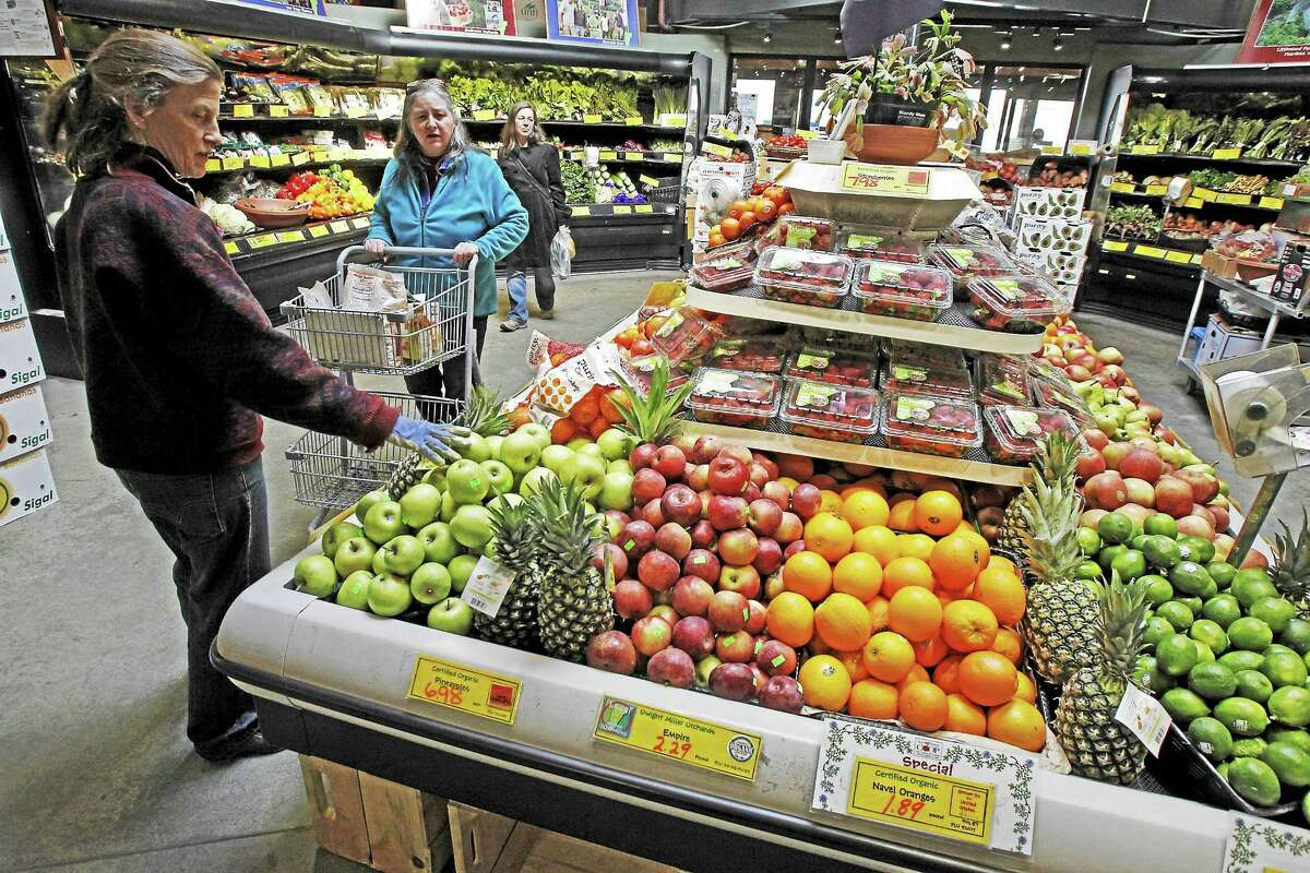 This April 16, 2013, file photo shows customers shopping for produce at the Hunger Mountain Co-op in Montpelier, Vt. Vermont's 17 food cooperatives are supporting a bill that would require the labeling of genetically modified foods.