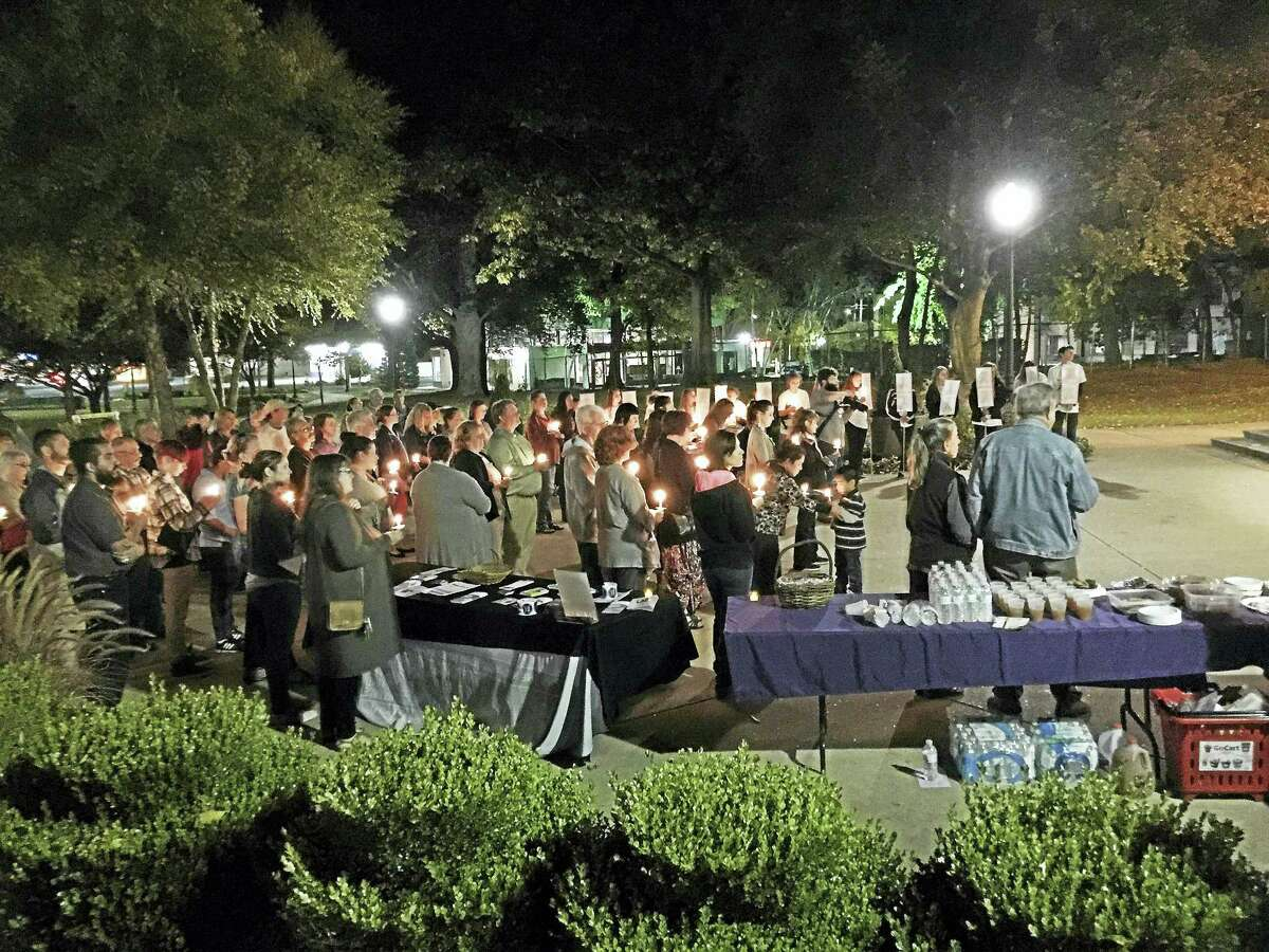 Ben Lambert - The Register CitizenResidents gathered for the 28th annual domestic violence awareness vigil at Coe Memorial Park in Torrington Wednesday night. The event is hosted each year by the Susan B. Anthony Project.