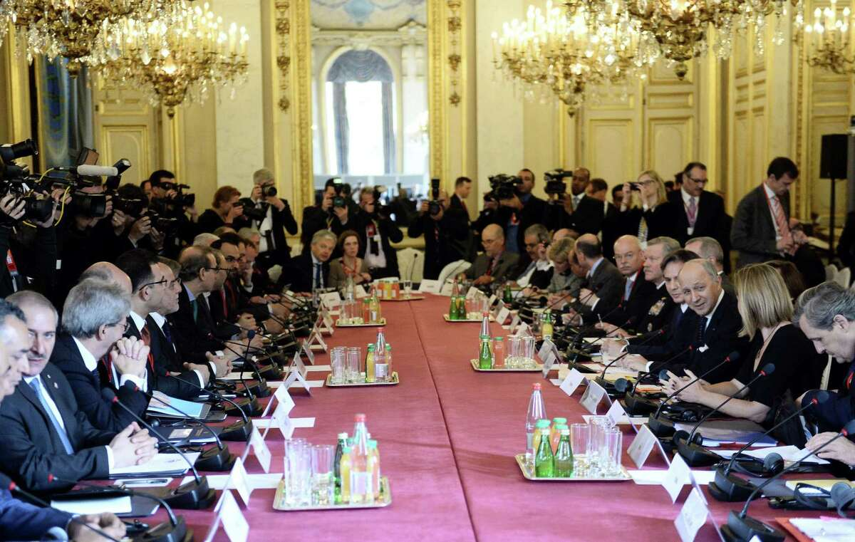 Foreign Ministers and members of the anti-Islamic State coalition meet in Paris, France, to discuss strategy in fighting the jihadists who have made key battlefield advances in recent weeks in Iraq and Syria, Tuesday, June 2, 2015. Iraqís prime minister and international allies are gathering in Paris to re-examine their strategy against Islamic State extremists, after the groupís recent gains. The coalition, which includes the United States and France but not Russia, Iran or Syria, is meeting Tuesday after extremists conquered both the Iraqi city of Ramadi and the historic Syrian city of Palmyra. (Stephane de Sakutin/Pool Photo via AP)