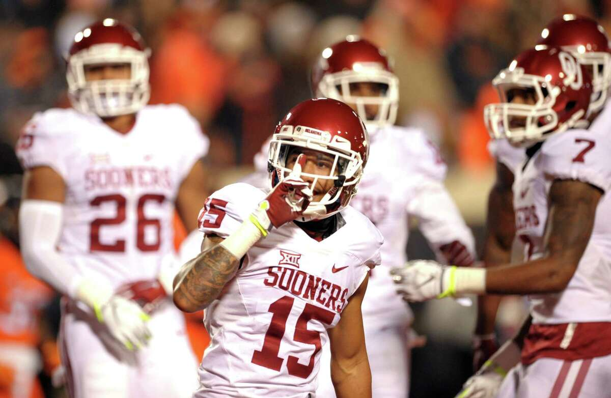 Oklahoma cornerback Zack Sanchez gestures to Oklahoma State fans following a teammate's touchdown on Saturday.