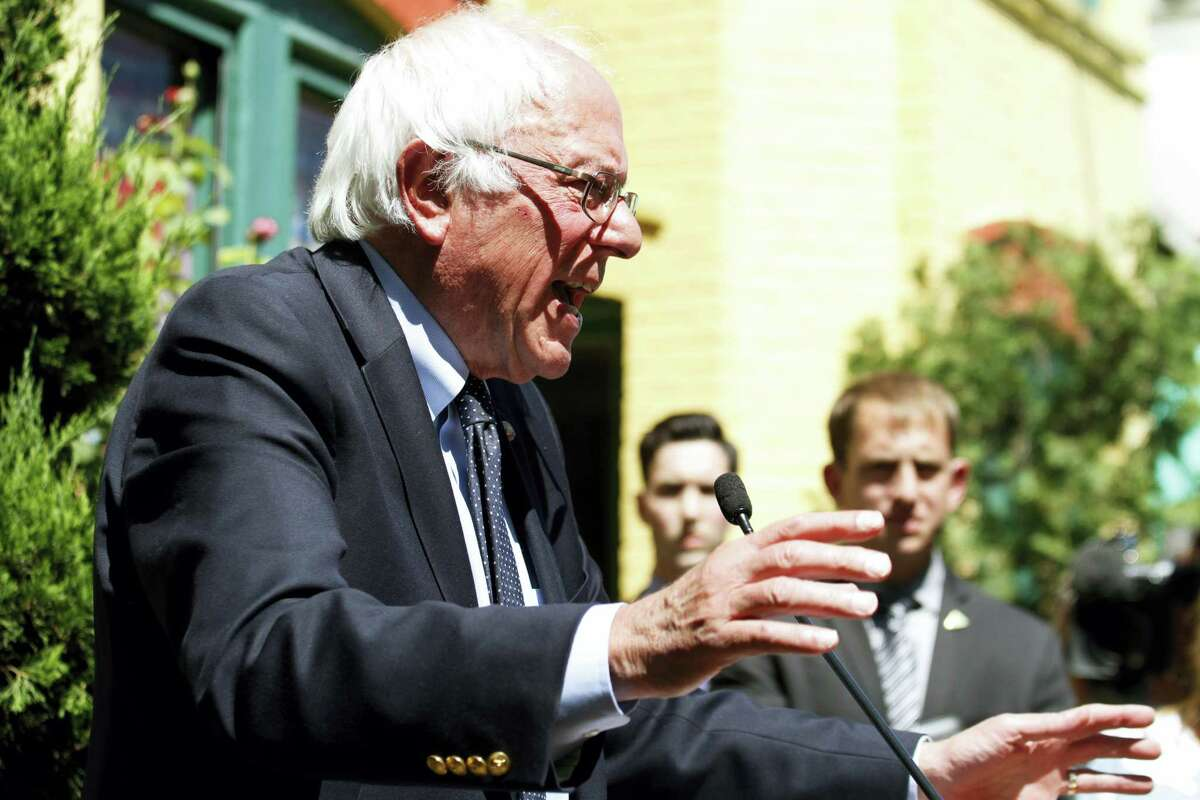 Democratic presidential candidate, Sen. Bernie Sanders, I-Vt., speaks during a news conference outside his campaign headquarters in Washington, Tuesday, June 14, 2016.