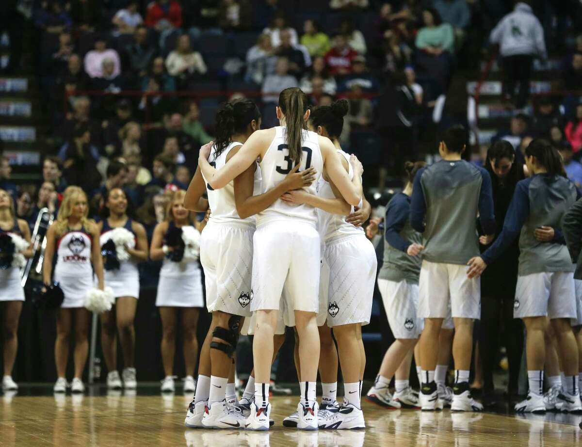 Connecticut players huddle during the first half of a women's college basketball regional semifinal game against Texas in the NCAA Tournament on Saturday, March 28, 2015, in Albany, N.Y. (AP Photo/Mike Groll)