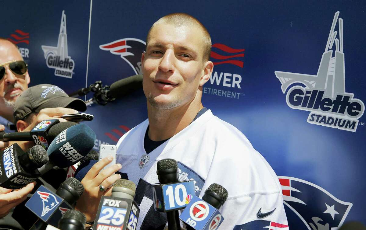 Patriots tight end Rob Gronkowski (87) speaks with reporters following practice on Monday.