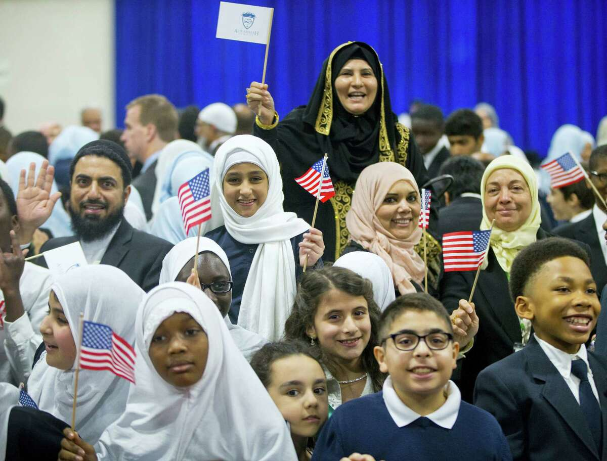 Children from Al-Rahmah school and other guests react after seeing President Barack Obama during his visit to the Islamic Society of Baltimore, Wednesday, Feb. 3, 2016, in Baltimore, Md. Obama is making his first visit to a U.S. mosque at a time Muslim-Americans say they're confronting increasing levels of bias in speech and deeds.