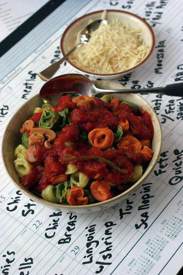 ** FOR USE WITH AP WEEKLY FEATURES ** Nightly meal planning can be made a little easier by thinking ahead, way ahead. Creating a list of meals and organizing them on a calendar can help avoid the often asked question of what to have for dinner tonight. (AP Photo/Larry Crowe) Photo: LARRY CROWE, STR / AP