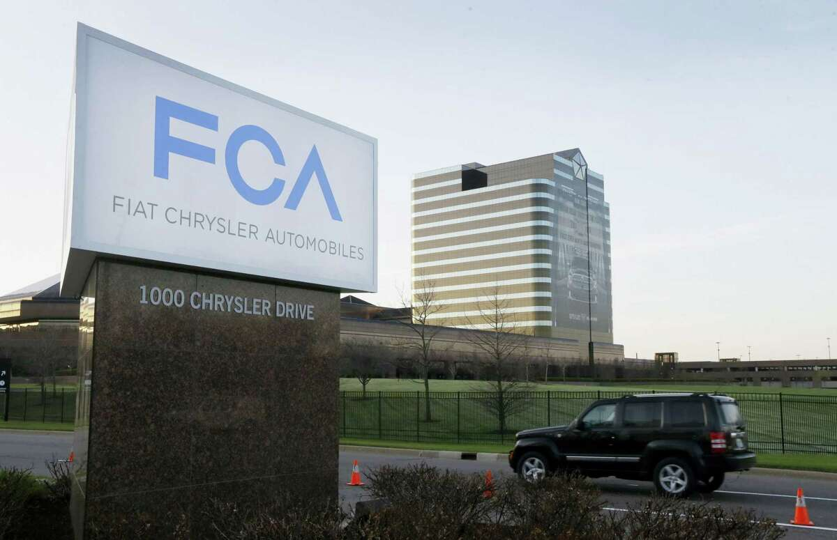 AP Photo/Carlos Osorio, File In this May 6, 2014 photo, the Fiat Chrysler Automobiles sign is seen at Chrysler World Headquarters in Auburn Hills, Mich.