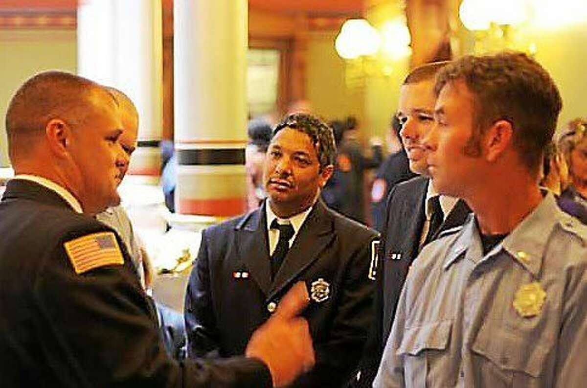 Members of the Bristol Fire Department lobby at the state capitol