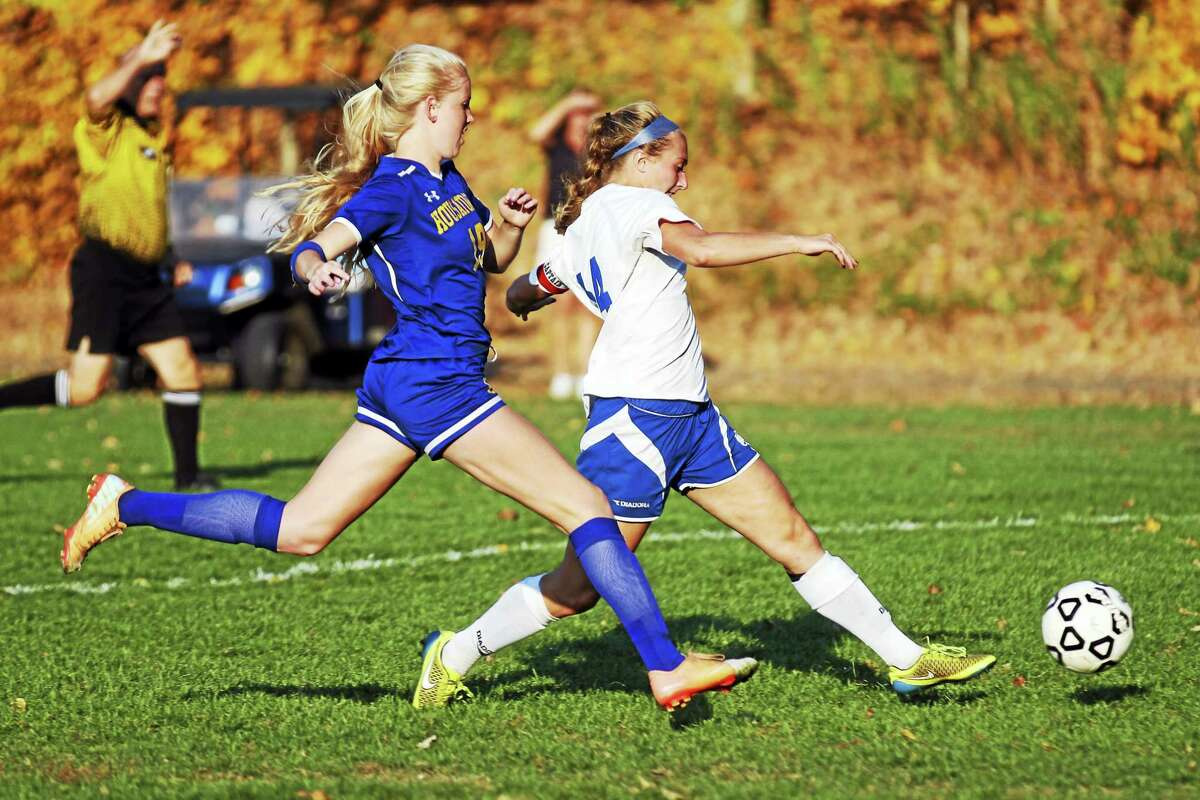Housatonic's Emily Geyselaers, left, and Nonnewaug's Christina Sordi made a good match all afternoon in a tight win by the Chiefs at Nonnewaug High School Tuesday afternoon.