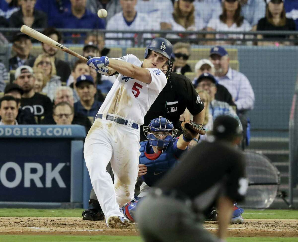 The Dodgers' Corey Seager hits an RBI single during the third inning on Tuesday.
