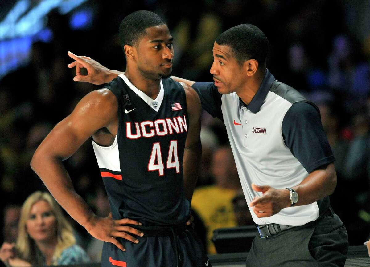 UConn coach Kevin Ollie has a word with guard Rodney Purvis (44) during a game against Michigan on Wednesday in Paradise Island, Bahamas.