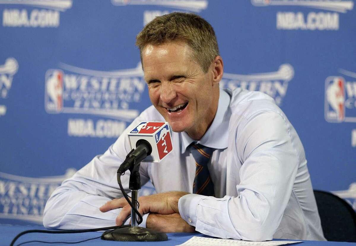 Golden State Warriors head coach Steve Kerr smiles at a news conference after Game 5 of the NBA Western Conference finals.