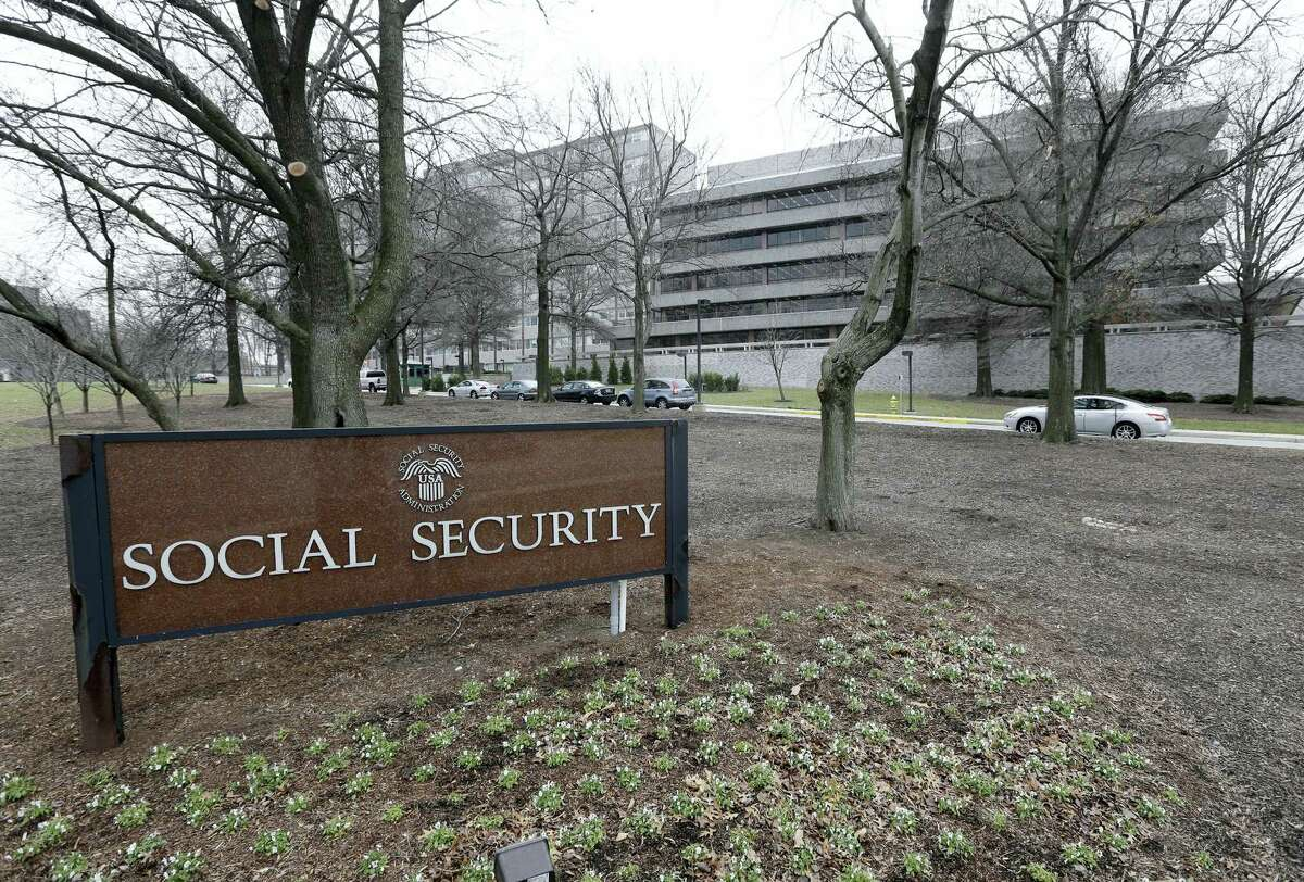 In this Jan. 11, 2013, file photo, the Social Security Administration's main campus is seen in Woodlawn, Md. Millions of Social Security recipients and federal retirees will get only tiny increases in benefits next year, the fifth year in a row that older Americans will have to settle for historically low raises.