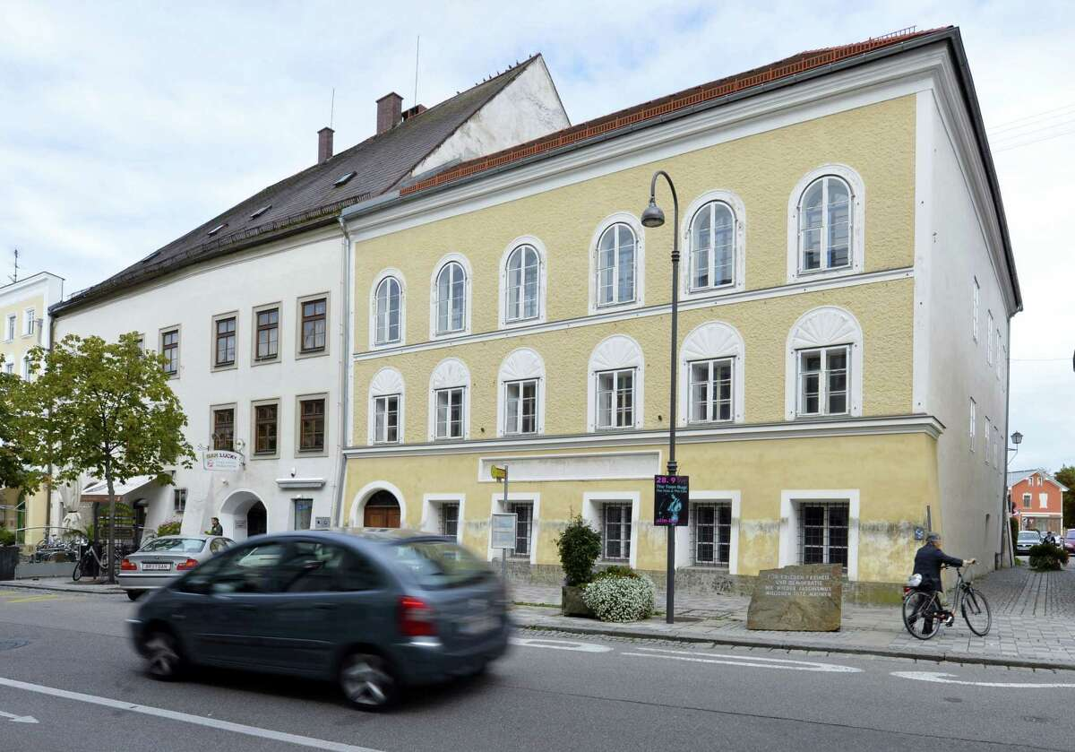 This Sept. 27, 2012, file picture shows an exterior view of Adolf Hitler's birth house, front, in Braunau am Inn, Austria. Austria's government said on Monday, Oct. 17, 2016 that it plans to tear down the house where Hitler was born and replace it with a new building.